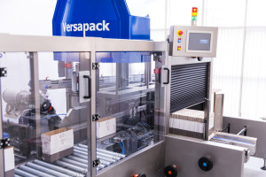 Integrated case packer, case erector and case sealer