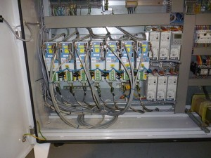 Photo of cabinet with upgraded servo drives, reusing existing motors, command cables, encoders ans control system.